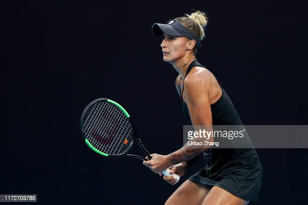 Polona Hercog of Slovenia in action against Angelique Kerber of Germany during the Women's Singles 2nd Round of 2019 China Open at the China National...