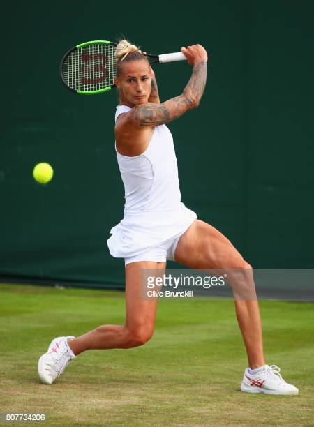 Polona Hercog of Slovenia plays a backhand during the Ladies Singles first round match against Annika Beck of Germany on day two of the Wimbledon...