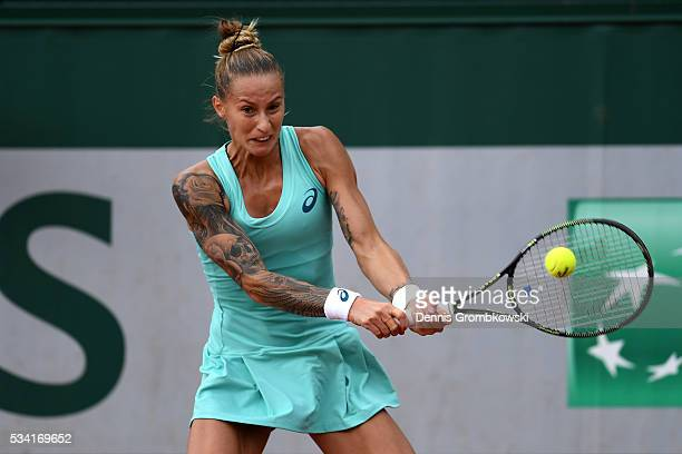 Polona Hercog of Slovenia plays a backhand during the Women's Singles second round match against Barbora Strycova of the Czech Republic on day four...