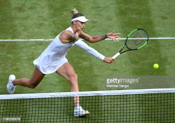Polona Hercog of Slovenia plays a backhand in her Ladies' Singles third round match against Cori Gauff of The United States during Day five of The...
