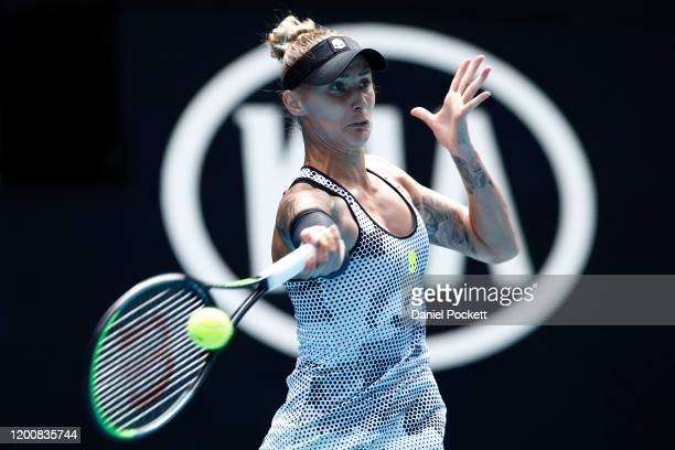 Polona Hercog of Slovenia plays a forehand during her Women's Singles first round match against Rebecca Peterson of Sweden on day two of the 2020...