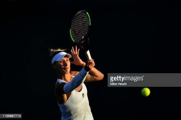Polona Hercog of Slovenia plays a forehand in her Ladies' Singles second round match against Madison Keys of The United States during Day three of...