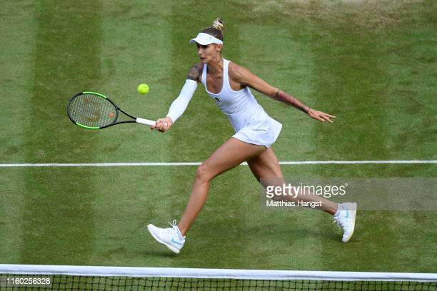 Polona Hercog of Slovenia plays a forehand in her Ladies' Singles third round match against Cori Gauff of The United States during Day five of The...