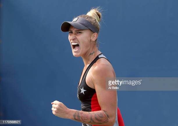 Polona Hercog of Slovenia reacts against Danielle Collins of the United States during their Women's Singles first round match on day two of the 2019...