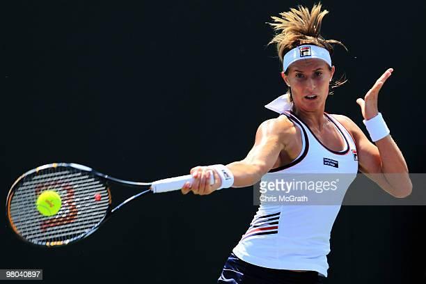Polona Hercog of Slovenia returns a shot against Aleksandra Wozniak returns during day three of the 2010 Sony Ericsson Open at Crandon Park Tennis...
