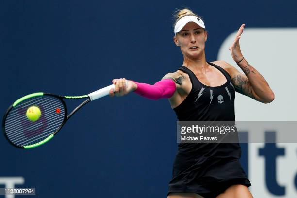 Polona Hercog of Slovenia returns a shot against Simona Halep of Romania during Day 7 of the Miami Open Presented by Itau at Hard Rock Stadium on...