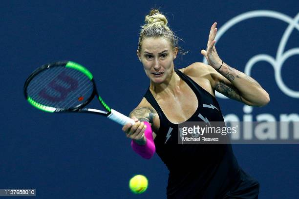 Polona Hercog of Slovenia returns a shot to Misaki Doi of Japan during Day 5 of the Miami Open Presented by Itau at Hard Rock Stadium on March 22...