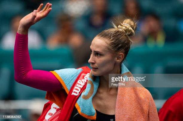 Polona Hercog of Slovenia waves to the crowd after losing to Simona Halep of Romania in the third round of the women's singles in the Miami Open at...