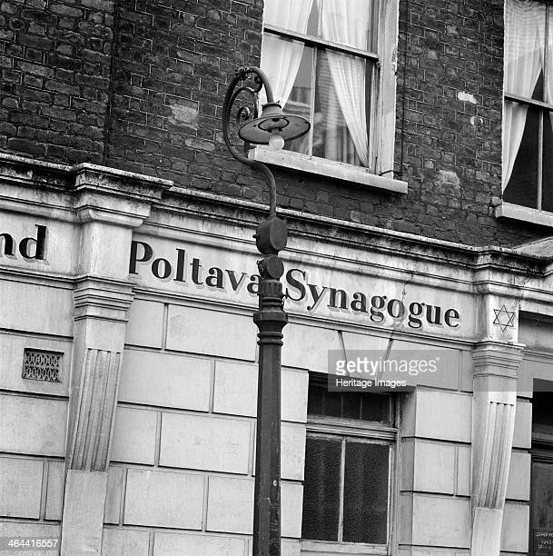 Poltava Synagogue Heneage Street Spitalfields London 19601965 The name of the Poltava Synagogue painted on the ground floor stucco with a lamppost in...