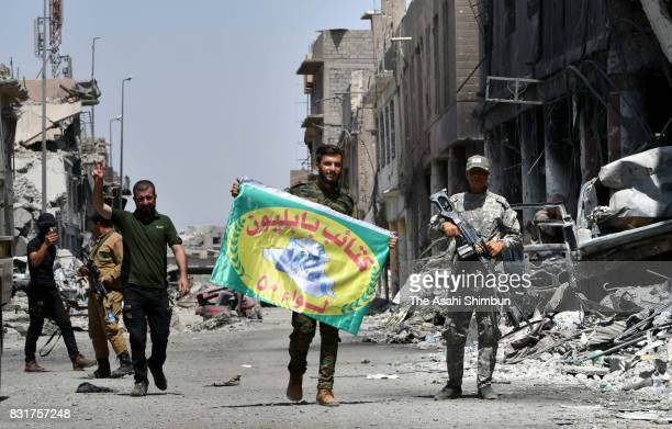 Polupar Mobilization Unit soldiers patrol in the rubble on August 10 2017 in Mosul Iran Iraqi Prime Minister Haider alAbadi declared the victory over...