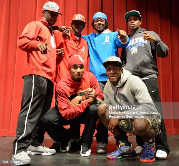 BEACH CALIF USA Poly High football player Gerard Wicks Jayon Brown and Thomas Tucker and basketball players Raschon Prince and Jordan Bell after...