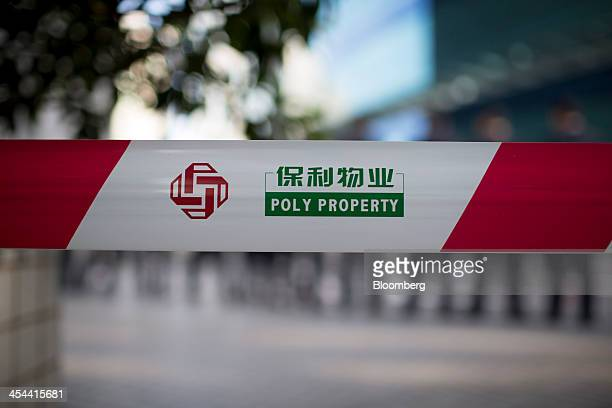 A Poly Property Group Co logo is displayed on barrier tape in the Tianhe district of Guangzhou Guangdong province China on Monday Nov 25 2013 New...