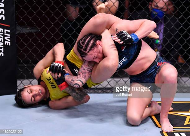 Polyana Viana of Brazil attempts to secure a submission against Mallory Martin in their strawweight fight during the UFC 258 event at UFC APEX on...