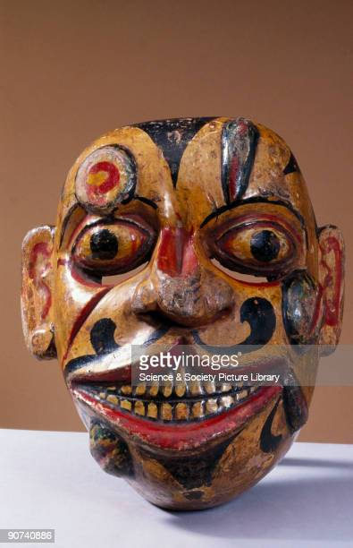A polychrome wooden disease mask covered with sores and leeches from the kolam masked play worn for healing rituals In some forms of traditional...