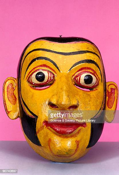 A polychrome wooden disease mask in the form of a human face used for healing rituals In some forms of traditional medicine healing powers lie in...