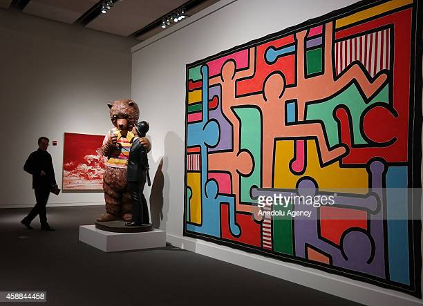 Polychromed wood sculpture 'Bear and Policeman' by American artist Jeff Koons sold for $8005 million while Keith Haring's 'Untitled' sold for $3077...