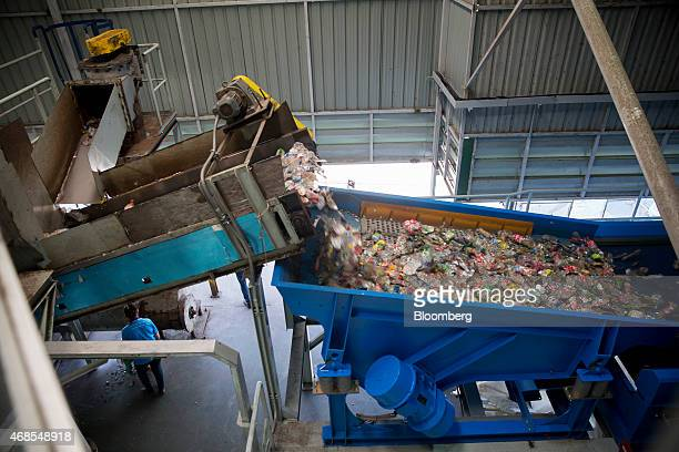 Polyethylene terephthalate bottles pass through a sorting machine at the Indorama Polyester Industries Pcl Nakhon Pathom recycling facility operated...