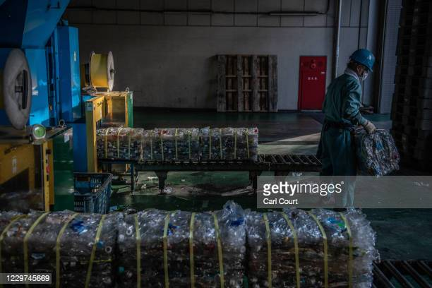 Polyethylene terephthalate plastic bottles are crushed into bales at Minato Resource Recycle Centre before being transported for either recycling or...