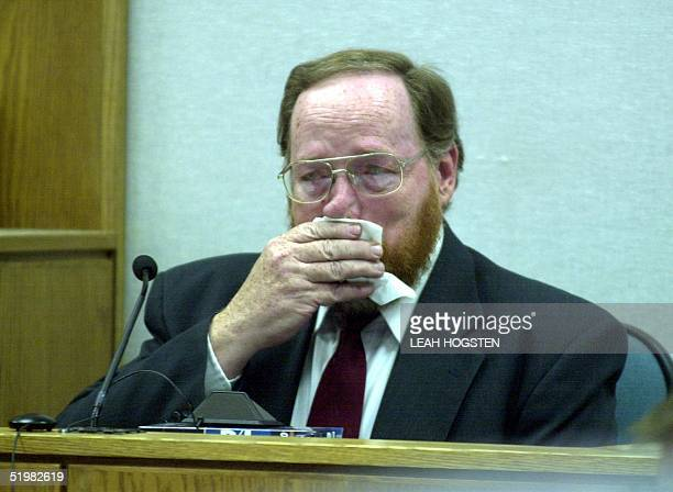 Polygamist Tom Green breaks into tears before members in the courtroom during Green's trial 17 May 2001 at 4th District Court in Provo Utah Green...