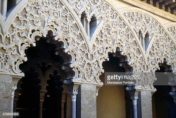'Polylobated Arches at the Aljaferia Palace by Mozarabic craftsmen 11th15th Century carved stone Spain Saragozza Detail Three of the richly ornate...