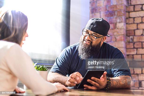 Polynesian businessman presenting with tablet