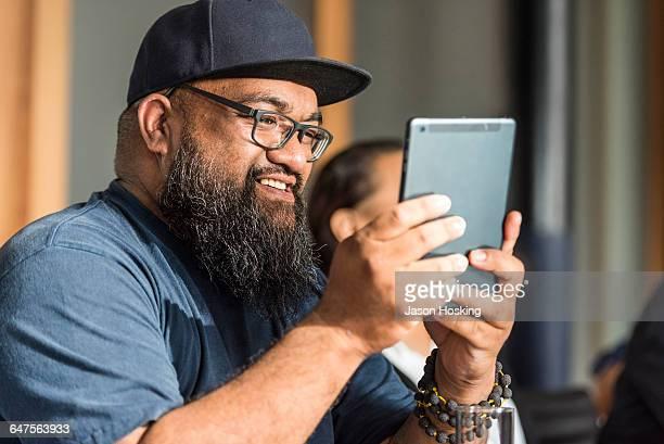 Polynesian Businessman using handheld device
