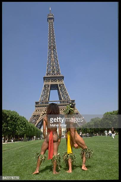 Polynesian dancers contemplate the Eiffel Tower