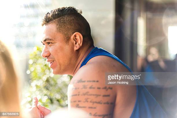 Polynesian man talking with girlfriend