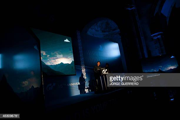 Polyphony Digital Inc president and creator of the series best selling PlayStation Gran Turismo Japanese Kazunori Yamauchi gives a speech during the...