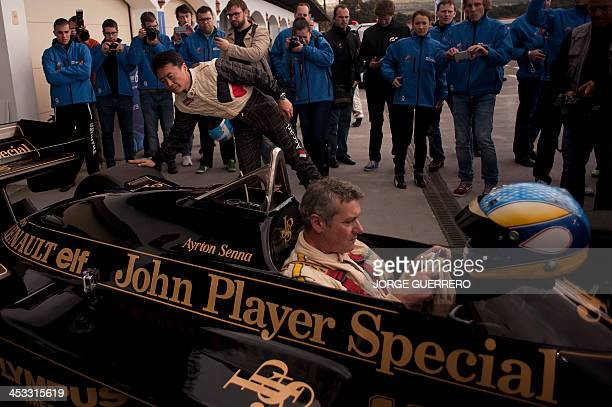 Polyphony Digital Inc president and creator of the series best selling PlayStation Gran Turismo Japanese Kazunori Yamauchi checks a lotus Ayrton...