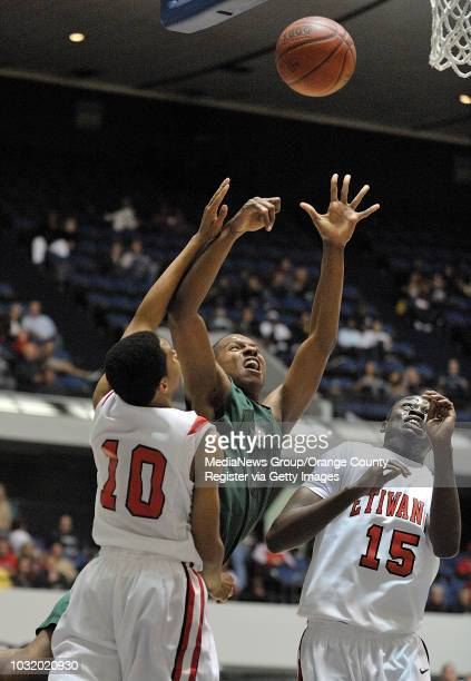 ANAHEIM CALIF USA Poly's Alex Carmon goes up for a shot against Etiwanda's Jordan Daniels and Troy Fiawoo during their CIFSS semifinal game in...