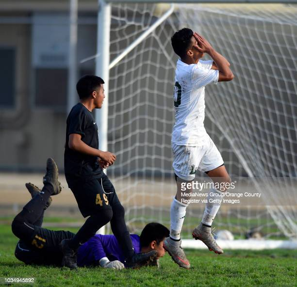 Poly's Peter Muro buries his face in his hands after missing a shot at a nearly open goal in Long Beach, CA on Wednesday, January 20, 2016....