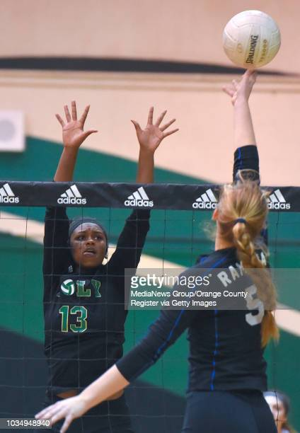 Poly's Taylor Walker leaps to put a block on RamonaÕs Amanda Donais in Long Beach on Wednesday November 15 2017 Poly played Ramona in the CIF State...
