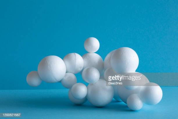 polystyrene balls glued together - cell structure - foam material stock pictures, royalty-free photos & images