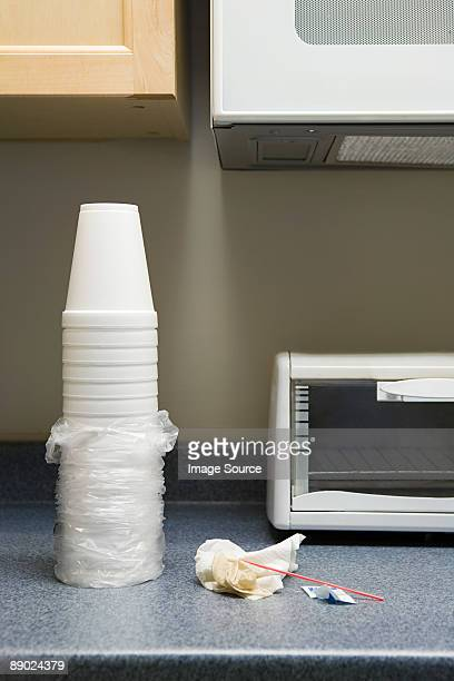 Polystyrene cups and rubbish on office kitchen counter