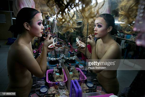 Pom a ladyboy dancer at the Chiang Mai Cabaret show puts on her makeup backstage as up to 20 dancers get dressed before a performance September 9...