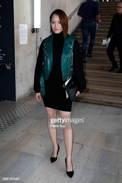 Pom Klementief attends the Acne Studios show as part of the Paris Fashion Week Womenswear Spring/Summer 2015 on September 27 2014 in Paris France