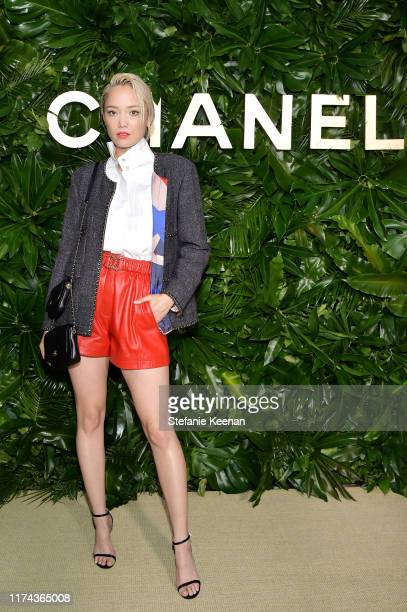 Pom Klementieffwearing CHANEL attends Chanel Dinner Celebrating Gabrielle Chanel Essence With Margot Robbie on September 12 2019 in Los Angeles...
