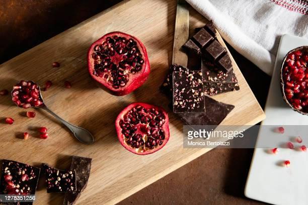 pomegranate and dark chocolate - ダークチョコレート ストックフォトと画像