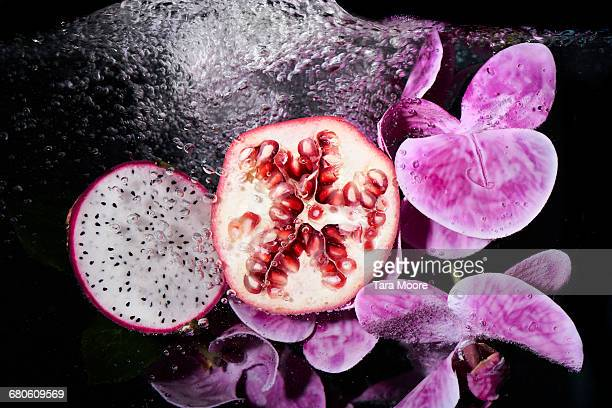 pomegranate and dragon fruit with water - tropical fruit stock pictures, royalty-free photos & images