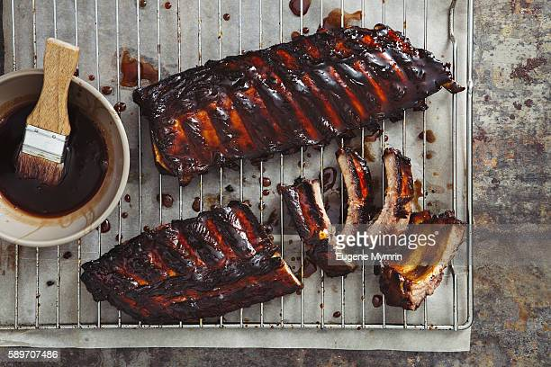 pomegranate and red wine glazed pork ribs - barbeque sauce stock photos and pictures