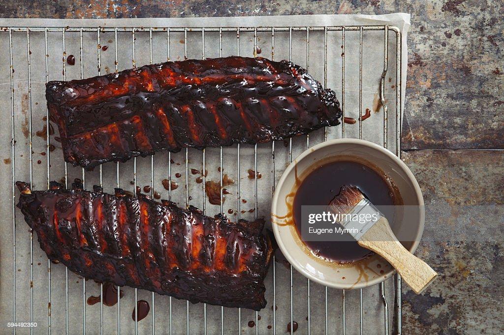 Pomegranate and red wine glazed pork ribs : Stock Photo