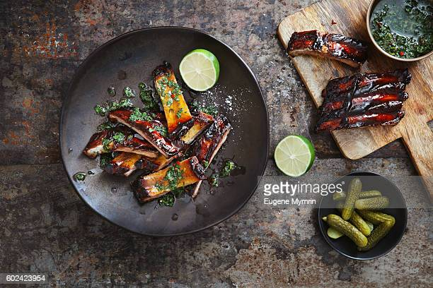 Pomegranate and red wine glazed pork ribs with chimichurri sauce