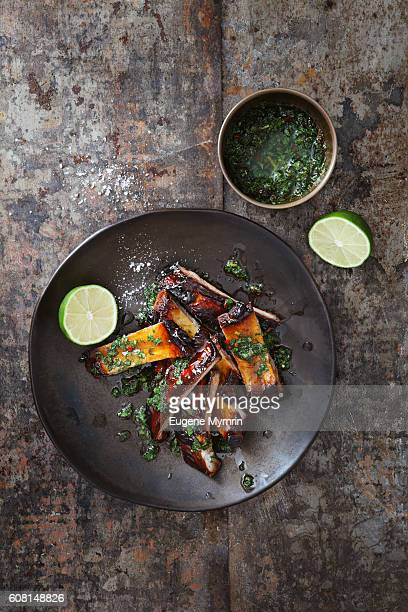 pomegranate and red wine glazed pork ribs with chimichurri sauce - barbeque sauce fotografías e imágenes de stock