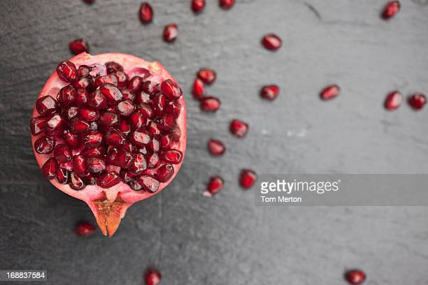 pomegranate and seeds - pomegranate stock pictures, royalty-free photos & images