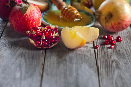 Pomegranate, apples and honey background 510515209