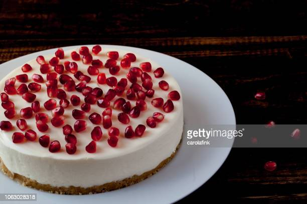 pomegranate cheesecake - carolafink stock photos and pictures