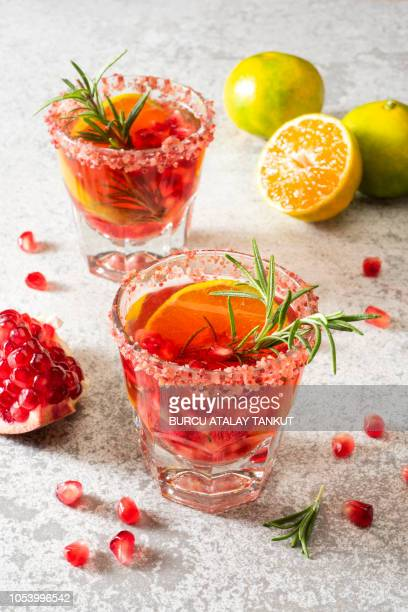 pomegranate drink with tangerine and rosemary - sangria stock pictures, royalty-free photos & images