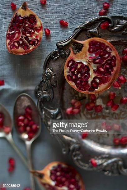 pomegranate segments and seeds on a silver platter - {{relatedsearchurl('london eye')}} stock photos and pictures