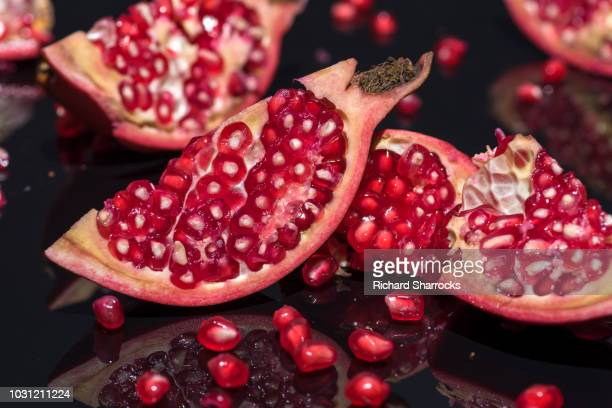 pomegranate slices - pomegranate stock pictures, royalty-free photos & images